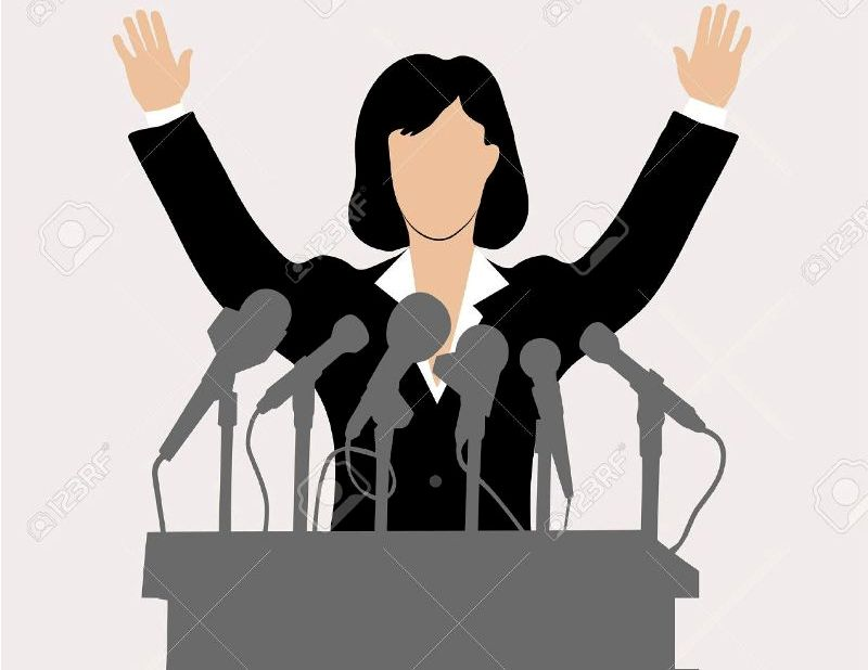 24751088-woman-politician-in-front-of-a-microphone-Stock-Vector